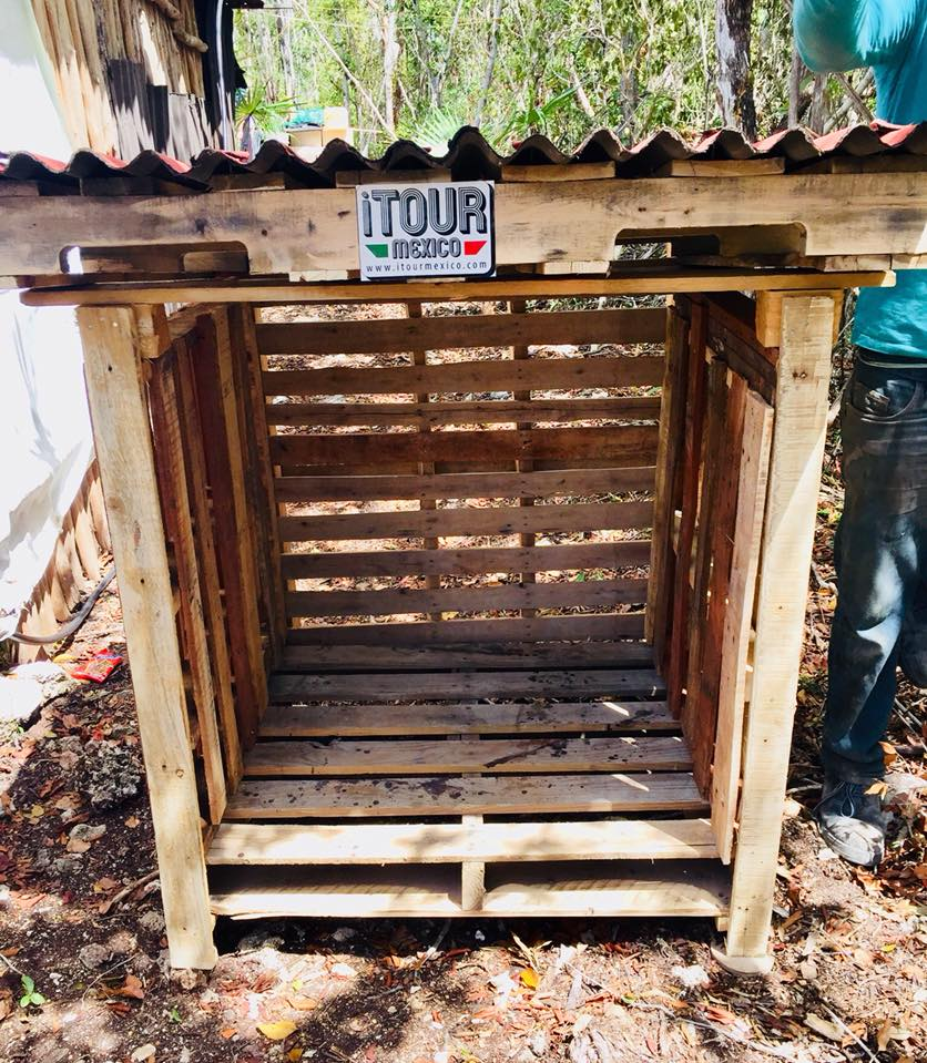 A local carpenter makes dog houses for street dogs in Tulum, south-east Mexico